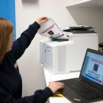 Quality save employee using a HP printer and Lenovo laptop provided by Midshire